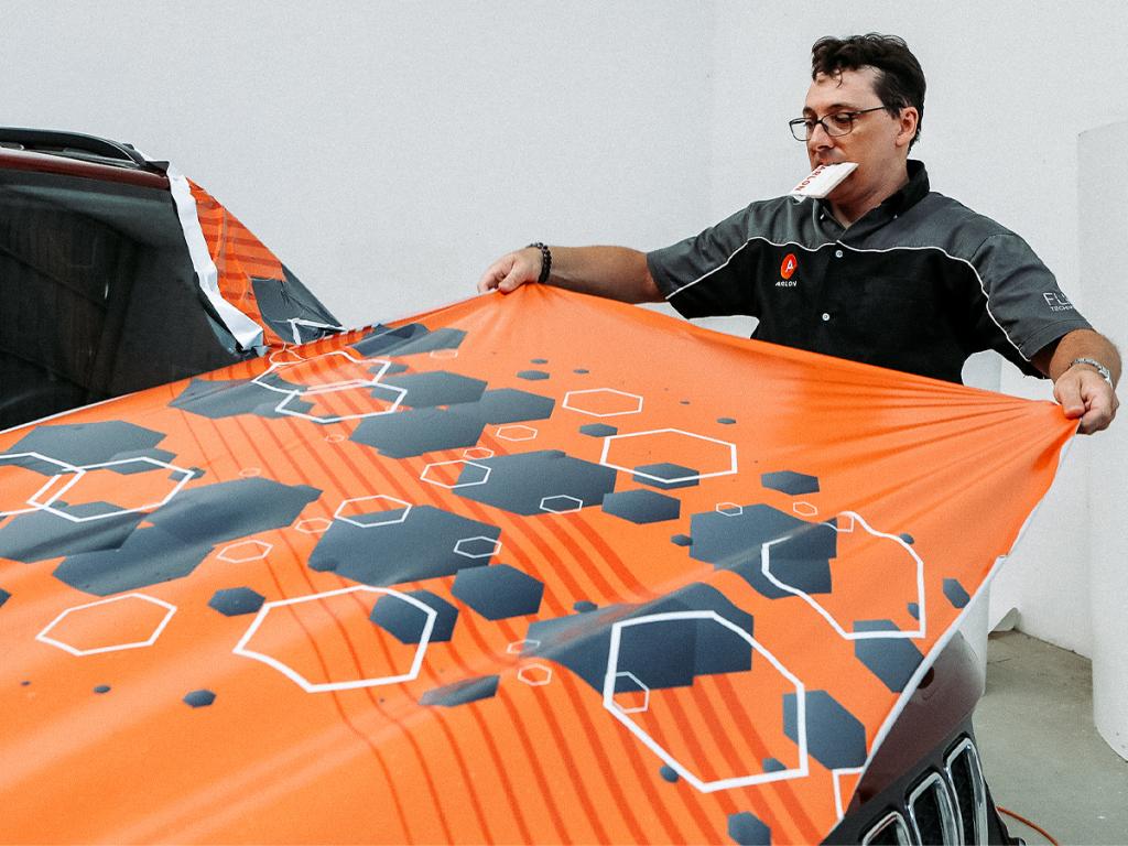 Arlon graphics trainer Alex installing Arlon SLX Cast Wrap with FLITE Technology vinyl on the hood of a vehicle